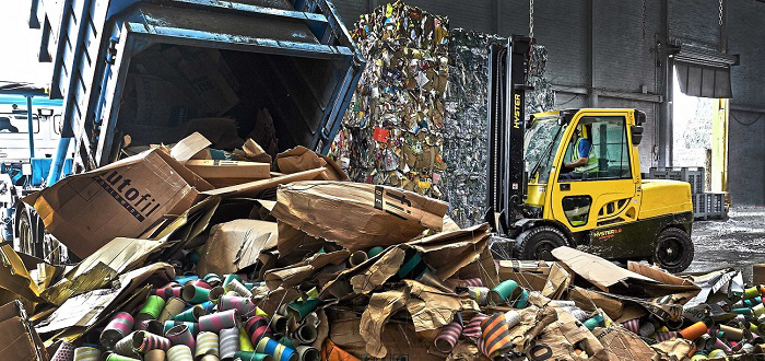 Hyster lowers handling costs for paper recyclers.