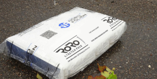 Film packaging protects paper bags from the environment.